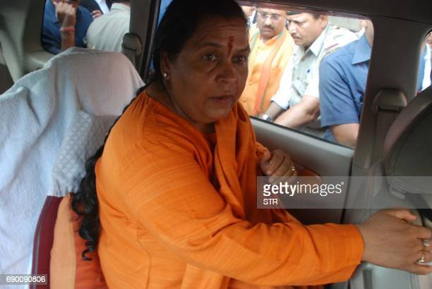 Indian Water Resources Minister Uma Bharati leaves after a court hearing in in Lucknow on May 30 2017 A special court May 30 charged three senior...