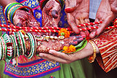 Indian bride and groom in traditional Indian wedding ceremony.