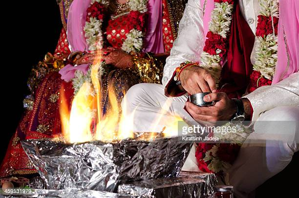 Indian Wedding Couple Worshipping The Fire Deity