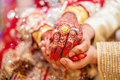 Indian wedding hands with gold