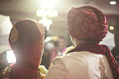 Rear view of Indian bridegroom posing during wedding ceremony