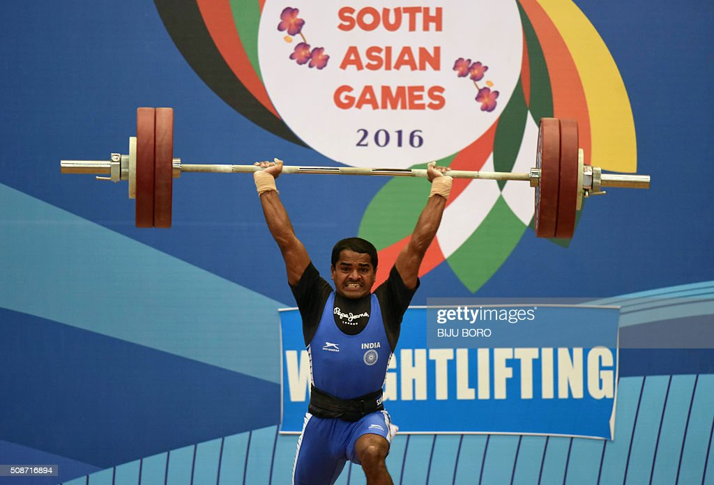 Indian weighlifter Guru Raja takes part in the 56 kg category event, in which he won a gold medal, during the 12th South Asian Games at the Bhogeswari Phukanani Indoor Stadium in Dispur in Guwahati on February 6, 2016. AFP PHOTO/ Biju BORO / AFP / BIJU BORO