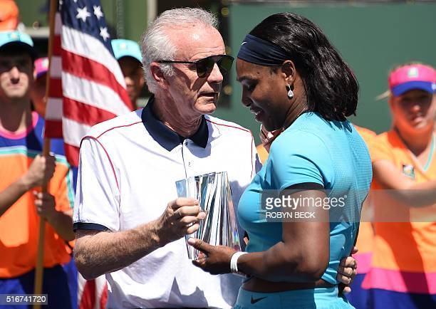 Indian Wells Tennis Garden CEO Raymond Moore presents the second place trophy to Serena Williams of USA after the women's final of the BNP Paribas...