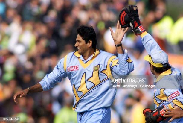 Indian wicketkeeper Nayan Mongia congratulates Venkatesh Prasad after Prasad claimed the wicket of Pakistan's Moin Khan during theirWorld Cup cricket...