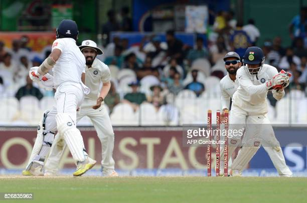 Indian wicketkeeper Wriddhiman Saha stumps Sri Lankan cricketer Dilruwan Perera during the fourth day of the second Test match between Sri Lanka and...