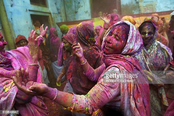 Indian widows dance as they celebrate Holi or 'festival of colors' in Vrindavan on March 3 2015 Widows congregated on a small patio of the ashram in...