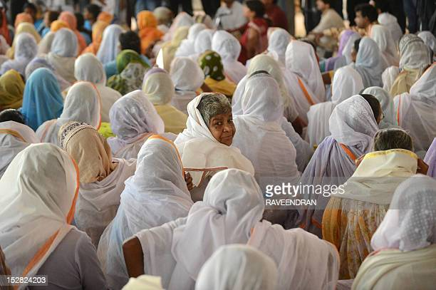 Indian widows from Vrindavan the northern state of Uttar Pradesh lissten to speakers during a function in New Delhi on September 27 2012 Sulabh...