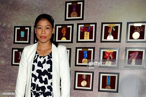 Indian woman boxer Mary Kom poses during the music launch of the upcoming Indian biographical sports drama Hindi film 'MARY KOM' directed by Omung...