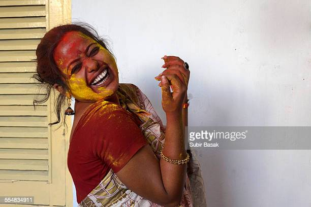 Indian woman celebrating Holi festival
