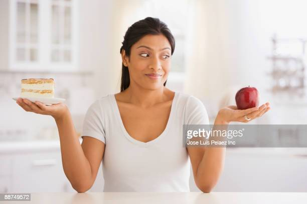Indian woman choosing snack
