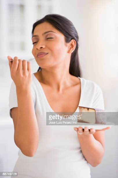 Indian woman eating cake