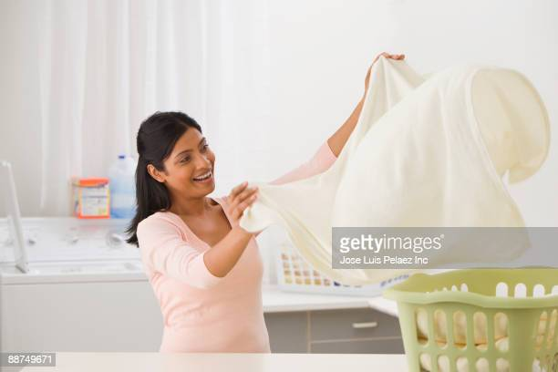 Indian woman folding laundry