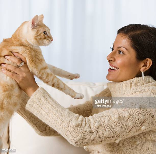 Indian woman holding cat