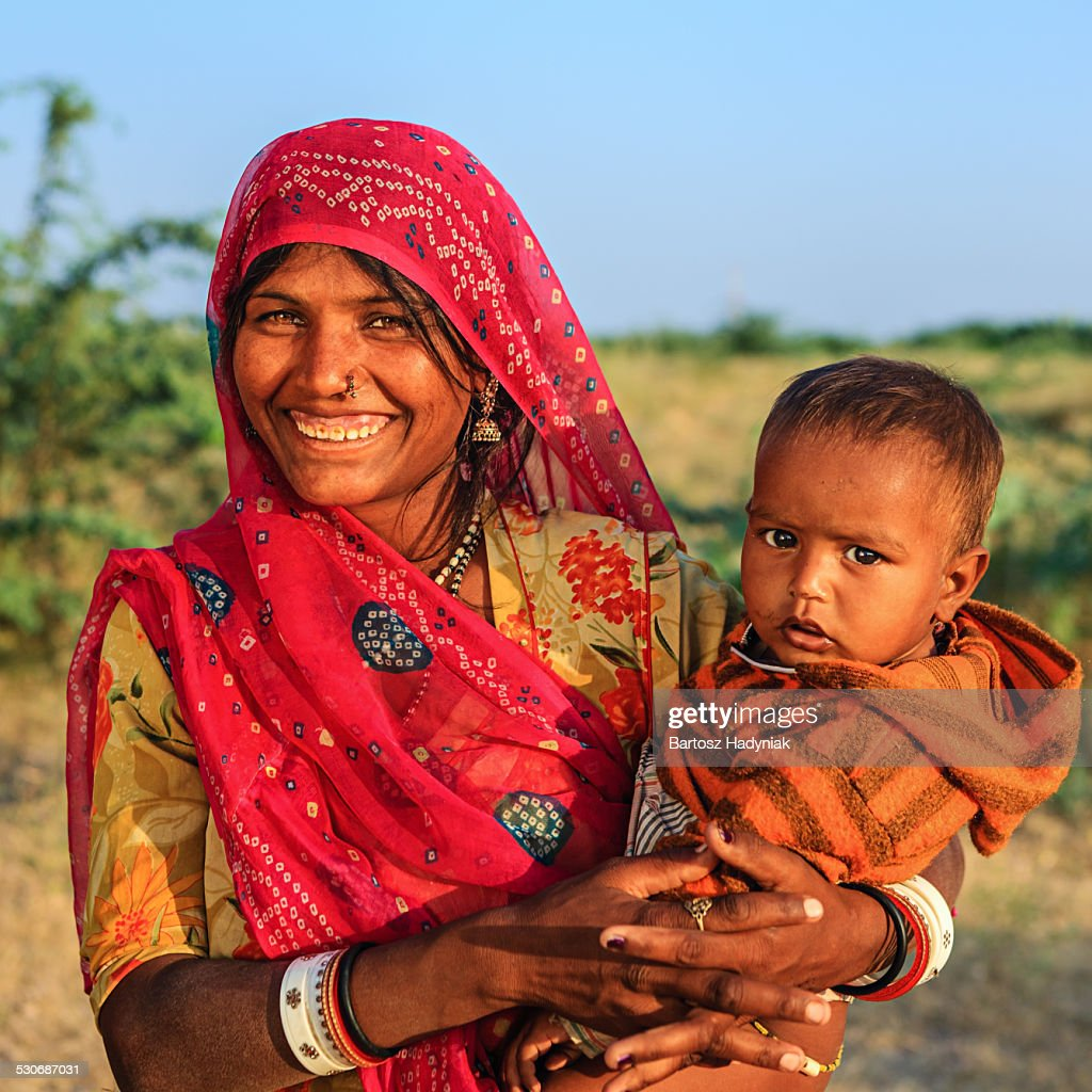 Indian woman holding her baby