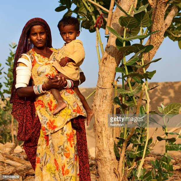Indian woman holding her child