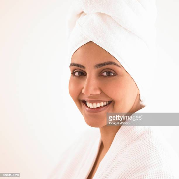 Indian woman in dressing gown and towel.