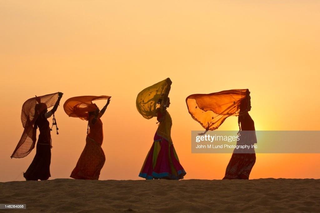 Indian woman in traditional clothing in desert