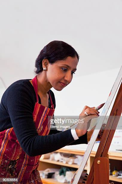 Indian woman painting