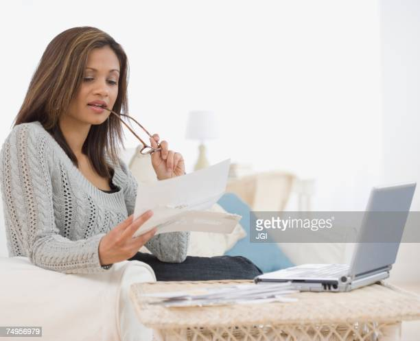 Indian woman paying bills