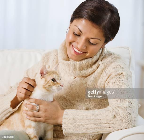 Indian woman petting cat