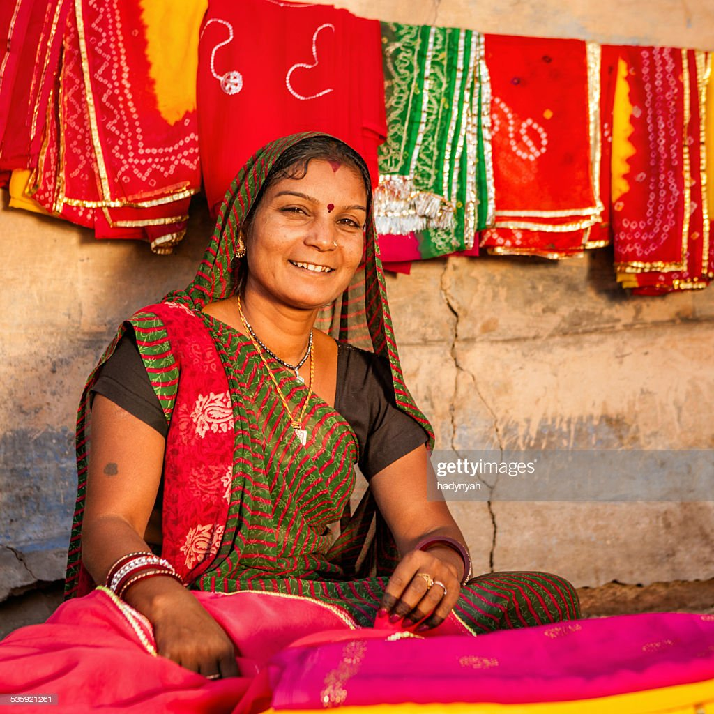 Indian woman selling colorful fabrics : Stock Photo