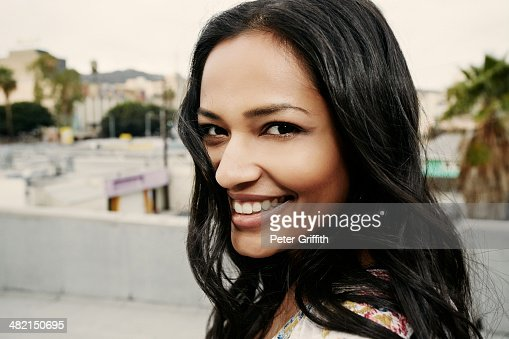 Indian woman smiling on urban rooftop