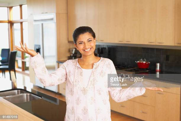 Indian woman standing in kitchen