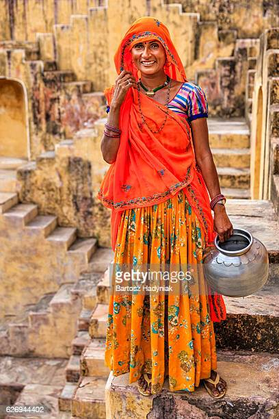 Indian woman standing inside stepwell near Jaipur, India