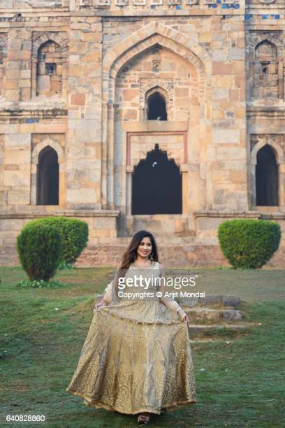 Indian Woman Walking Like a Princess Front of a Historical Monument Shisha Gumbad at Lodhi Gardens with Traditional Ethnic Clothing