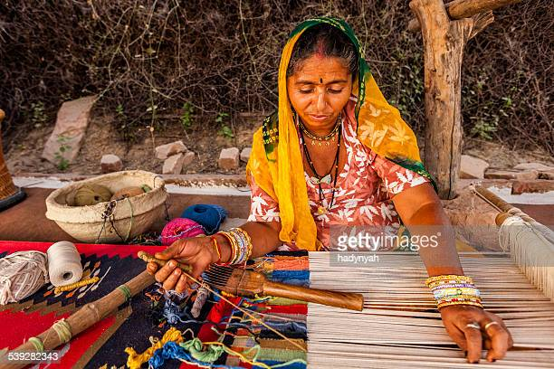 Indian woman weaving textiles (durry) in Rajasthan