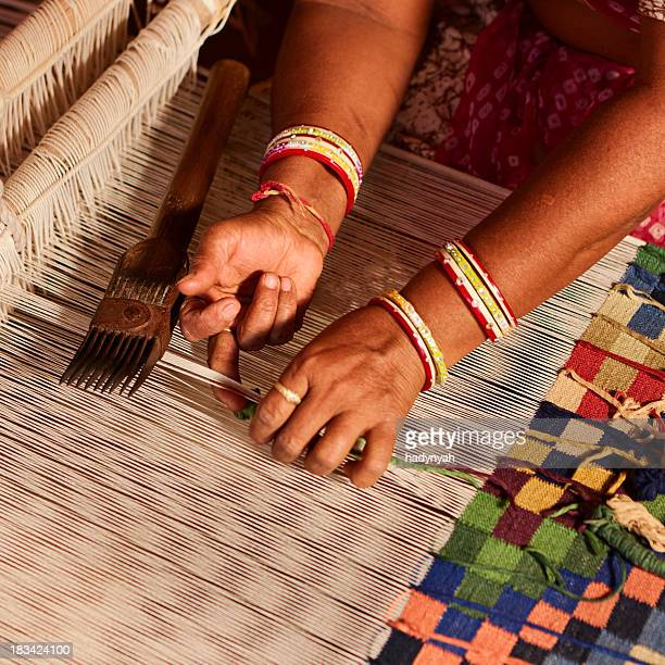Indian woman weaving textiles (durry). Salawas village. Rajastha