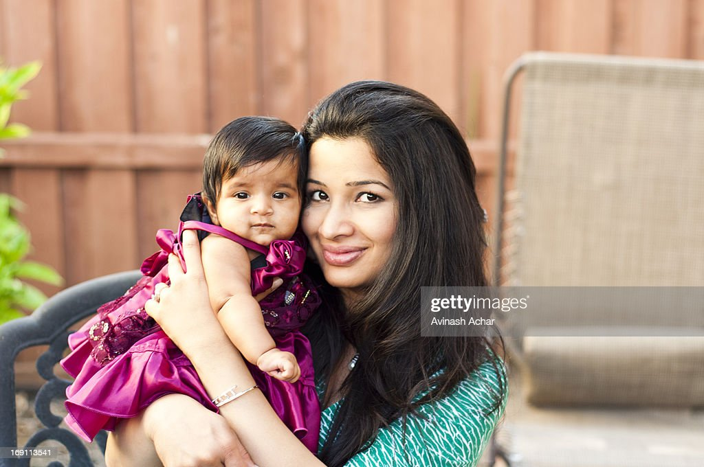 Happy woman with her baby | Stock Photo | Colourbox