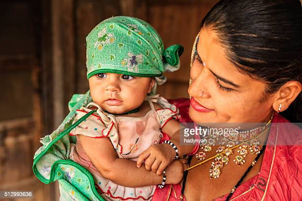 Indian woman with her newborn daughter, Bishnoi village