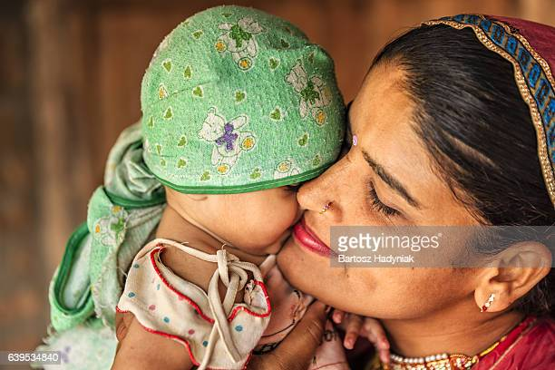 Indian woman with her newborn daughter, Bishnoi village