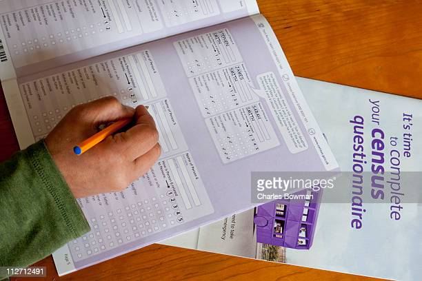 Indian woman's hand fills in UK Census 2011
