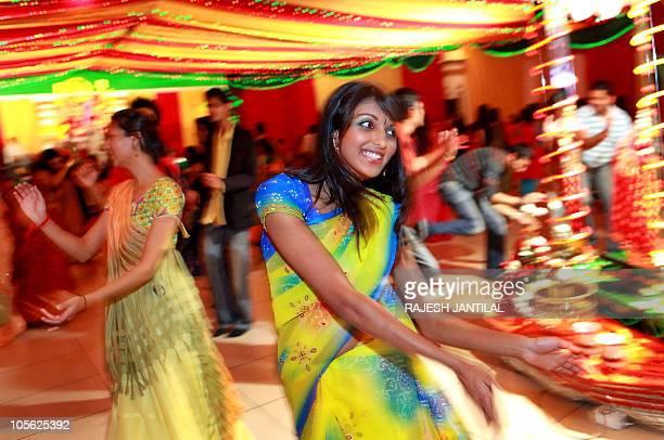 Indian women adorning traditional attire perform the Garba dance marking The Navratri Festival at the Gujarati Hindu Sanskruti temple in Durban on...