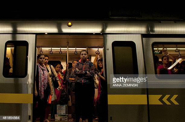 Indian women are framed in the doorway as they travel in the carriage reserved for women on the metro in New Delhi on July 3 2015 AFP PHOTO/ Anna...