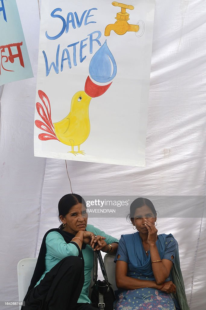 Indian women attend a demonstration against the shortage of drinking water in their residential colony on World Water Day in New Delhi on March 22, 2013. Hundreds of activists marched towards parliament demanding that the government guarantees the supply of clean drinking water, as ordered by the Supreme Court of India.