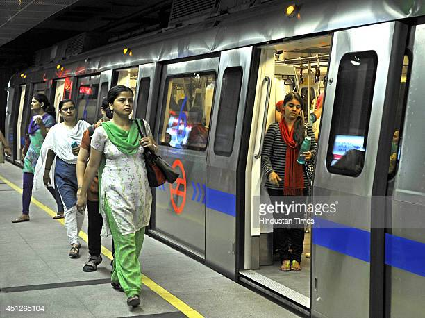 Indian women board Women Only metro train compartment after the inauguration of Mandi HouseCentral Secretariat line on June 26 2014 in New Delhi...