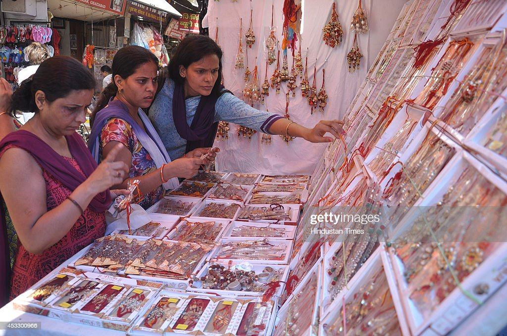 Indian women buy Rakhis ahead of Raksha Bandhan on August 7, 2014 in Ghaziabad, India. The festival of Raksha Bandhan' or 'Rakhi' celebrate the brother-sister love. Sisters tie sacred Rakhi string on their brothers' right wrists and pray for their protection.