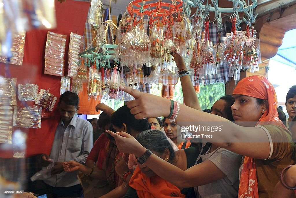 Indian women buy Rakhis ahead of Raksha Bandhan on August 7, 2014 in Jaipur, India. The festival of Raksha Bandhan' or 'Rakhi' celebrate the brother-sister love. Sisters tie sacred Rakhi string on their brothers' right wrists and pray for their protection.
