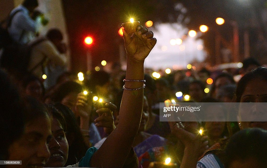 """Indian women carry torches during a women's march in an effort to bring awareness to violence against gender in Mumbai on December 10, 2012. A recent report by the New Delhi-based National Crimes Record Bureau (NCRB) found that a """"total of 228,650 incidents of crime against women were reported in the country during the year 2011 as compared to 213,585 incidents in the year 2010, recording an increase of 7.1 percent."""" People worldwide are celebrating Human Rights Day today."""