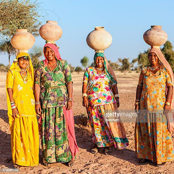 Indian women carrying water on heads, Rajasthan