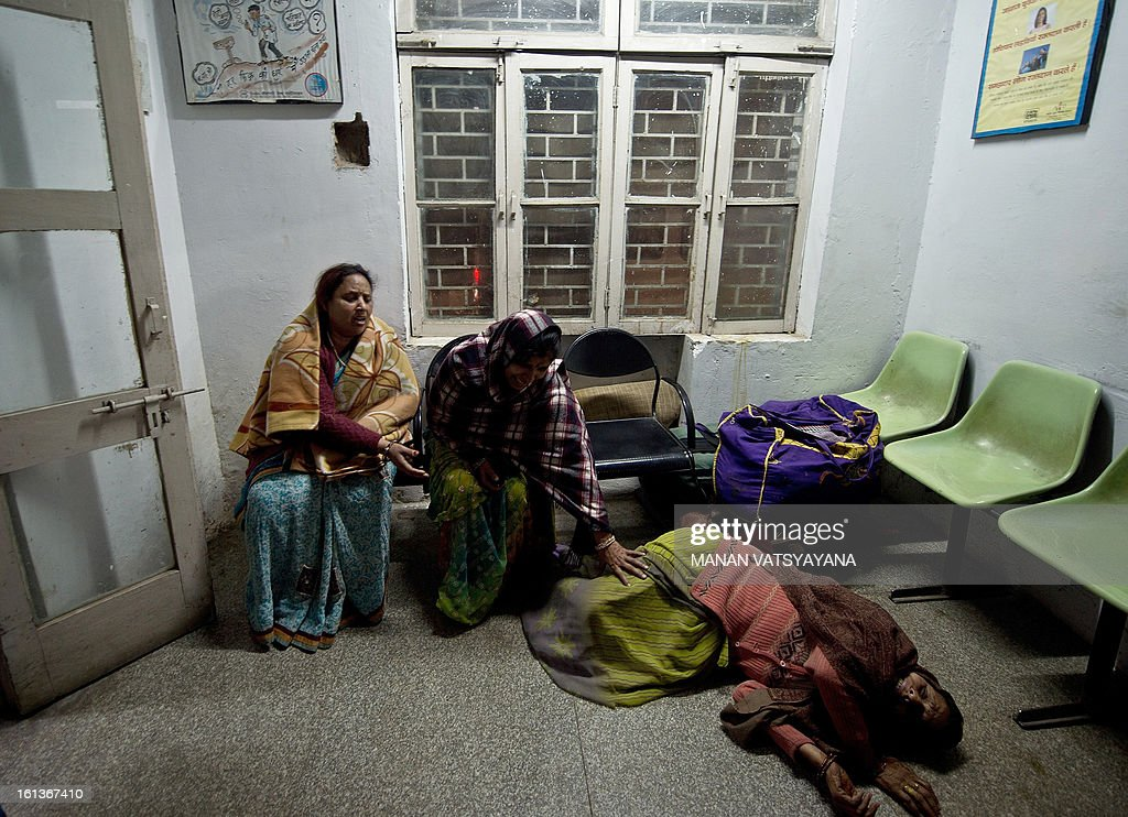 Indian women, caught in a stampede, reacts after not finding their relatives whom they last saw at the sight of the accident at the Railway Hospital in Allahabad on February 10, 2013. At least 10 people died in a stampede as pilgrims headed home from India's giant Kumbh Mela festival, which drew a record 30 million people to the banks of the river Ganges. The lives were lost at the main railway station where 10 corpses wrapped in white sheets could be seen on a train platform several hours after the incident which occurred in the early evening. AFP PHOTO/ MANAN VATSYAYANA