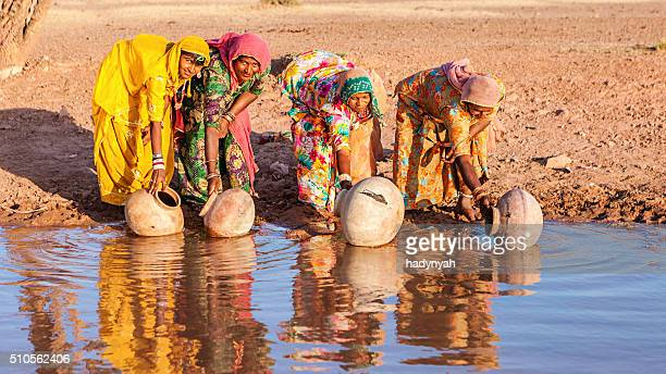 Indian women collecting water from a lake, Rajasthan