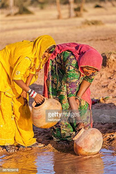 Indian women collecting water from local lake,Rajasthan