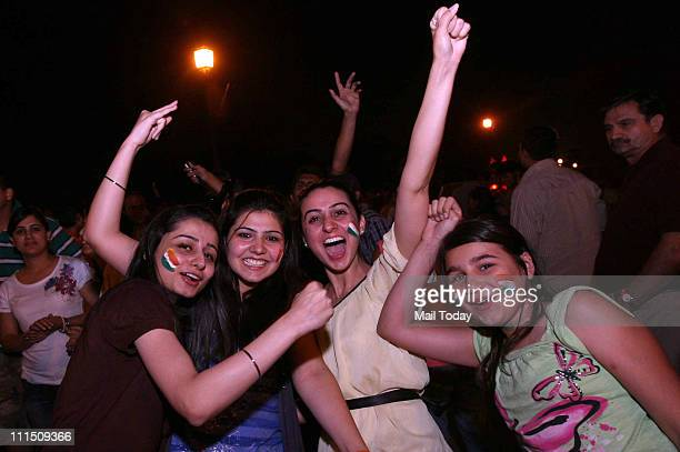 Indian women cricket fans celebrating at Connaught Place after India won the Cricket World Cup final against Sri lanka in New Delhi India Saturday...