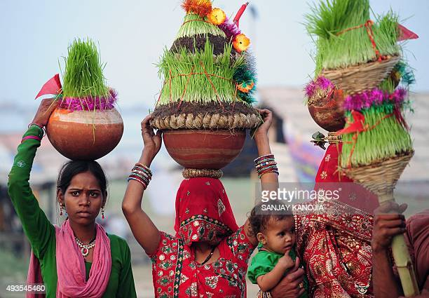 Indian women devotees carry barley saplings for offerings at Sangam during the 'Navratri' festival in Allahabad on October 20 2015 AFP PHOTO/SANJAY...