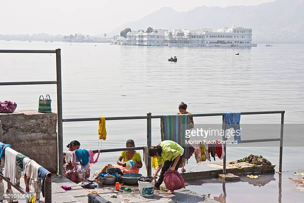 Indian women doing their laundry in Lake Pichola in Udaipur The White City