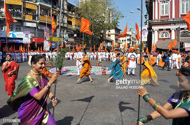 Indian women dressed in traditional attire take part in a procession to celebrate 'Gudi Padwa' or the Maharashtrian new year in Mumbai on April 4...